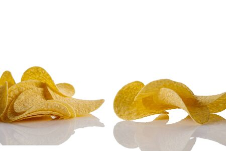 Salty delicious potato chips isolated on white background Фото со стока
