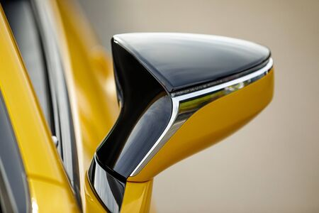 Side car mirror. Details of yellow sport car, close-up
