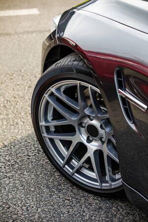 detail of car. front car wheel on the asphalt road