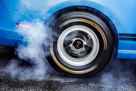 Drifting car. Drag racing car burns rubber off tires before the start Archivio Fotografico