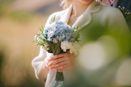 beautiful wedding bouquet of flowers in brides hands