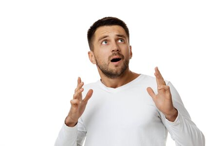 portrait of scared bearded man in casual white shirt isolated on white background. Im afraid.