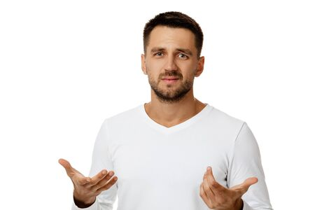 portrait of bearded man in casual white shirt telling something isolated on white background. man explains to someone