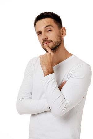 portrait of doubtful bearded man in casual white shirt asking questions isolated on white background.
