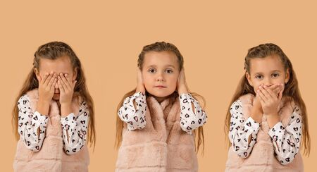 little child girl on beige background. I see nothing, hear nothing, nothing will not tell anyone Imagens