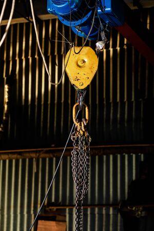 steel chain hook of electric hoist. industrial background. Factory crane hook