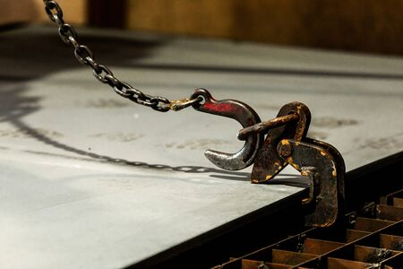 Crane chain and hook at an industrial plant. hooks for lifting steel Standard-Bild