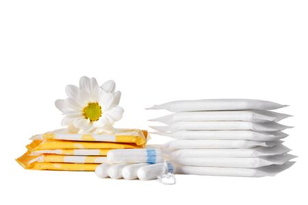 menstrual sanitary pads and cotton tampons on white background. Feminine hygiene products and chamomile flower. Imagens