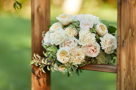 wedding bouquet of flowers and greenery with a ribbon outdoor Banco de Imagens - 155640875