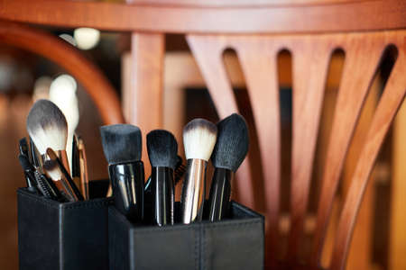 Professional makeup brushes on the wooden background Banco de Imagens