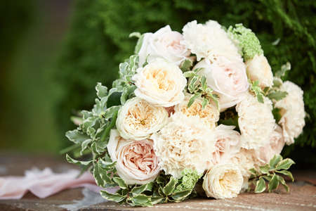 wedding bouquet of flowers and greenery with a ribbon outdoor Banco de Imagens - 156075749