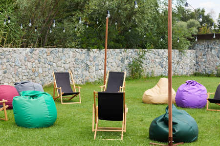 colorful bean bags and deck chairs outdoor. summer picnic