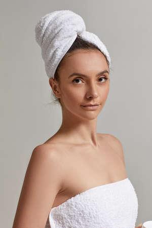 Brunette beautiful woman wearing white towel after the bathroom Banco de Imagens - 156205974