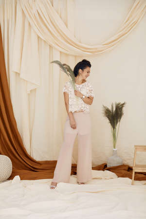 Fashion art photo of brunette woman in studio interior. soft light. full lenth photo. trendy fabric backgrounds Banco de Imagens