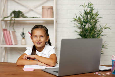 happy little child girl using laptop computer for studying online learning system.online education concept
