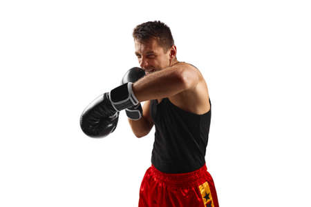 boxer man in black boxing gloves punching isolated on white background. Imagens