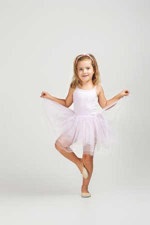 little child girl dreams of becoming a ballerina. ballet dancer in pink tutu