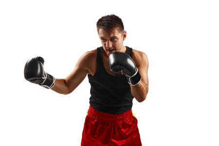 professional boxer man in black boxing gloves punching isolated on white background. Zdjęcie Seryjne