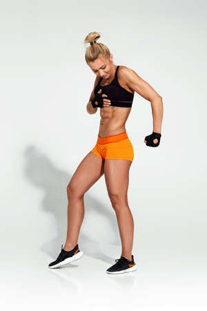 Strong woman in sportswear with perfect body Banco de Imagens