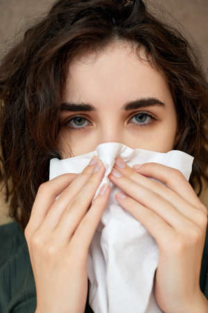 sick girl having influenza symptoms coughing at home