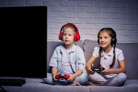 children playing video game with game console