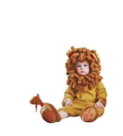 Adorable kid in lion costume on white background isolated