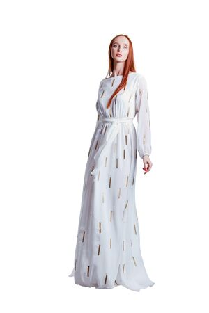 Beautiful red hair women model in white airy dress