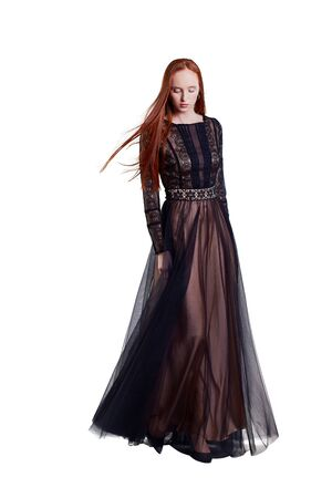 Beautiful red hair women model in long lace tulle and silk dress