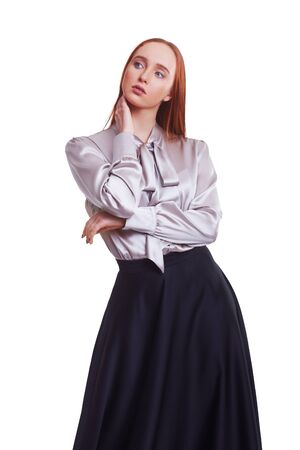 Beautiful red hair women model in grey silk shirt and black silk skirt