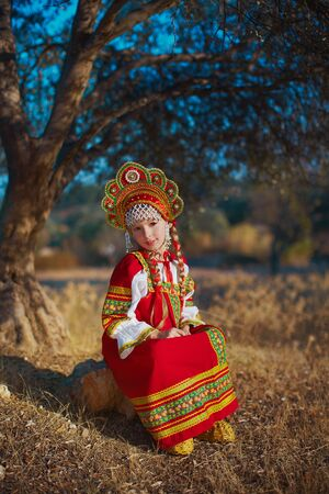 Russian small girl in traditional folk russian costume