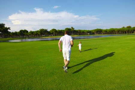 Father and son playing at golf field