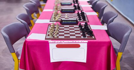 Chess tournament tables with chess timers and blank note papers 版權商用圖片