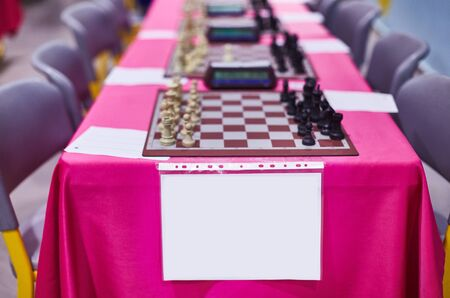 Chess tournament tables with chess timers and blank note papers Foto de archivo