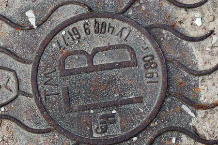 Old soviet  sewer hatch Archivio Fotografico