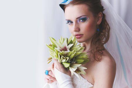 Bride in original MUAH with carnival mask