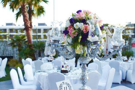 Luxury wedding decorated round tables