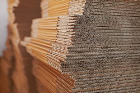 Big stuck of clean cardboard texture background close up