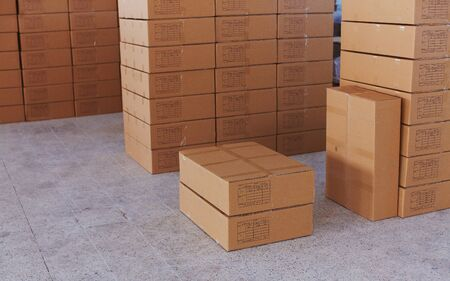 Boxes full of production with tags are prepared for cargo in beautiful bright small factory