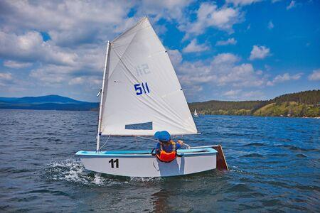 Sailing training yachting sport kids in lake