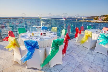 Festive decorated banquet tables on sea view venue 写真素材