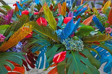 Bouguets of monstera for tables decoration on wedding or corporative event