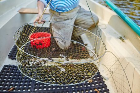 Process of cacthing crawfish and tackle in sweet water mountain lake