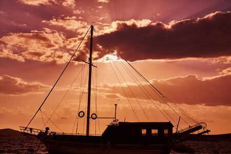 Sailing ship on sea view on sunset with beautiful sky
