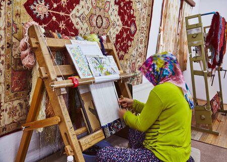 Persian carpet tailoring women in headcloth