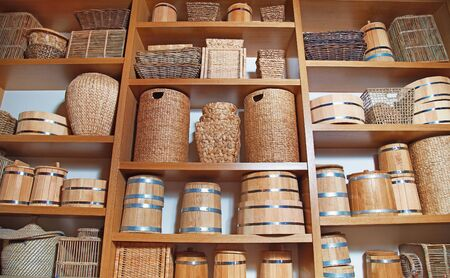 Room decoration in rustic style with many different baskets and barrels