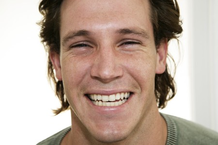 Portrait of male laughing at camera
