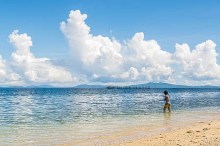 A beach with golden sand and blue skies Stock Photo