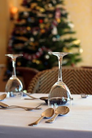 restaurant table with christmas tree as background