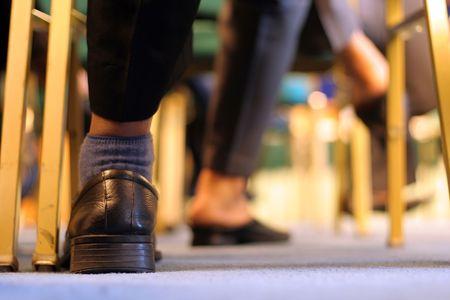 banquet facilities: executive feet in meeting room Stock Photo