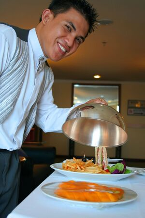 dinners: room service waiter showing the food Stock Photo